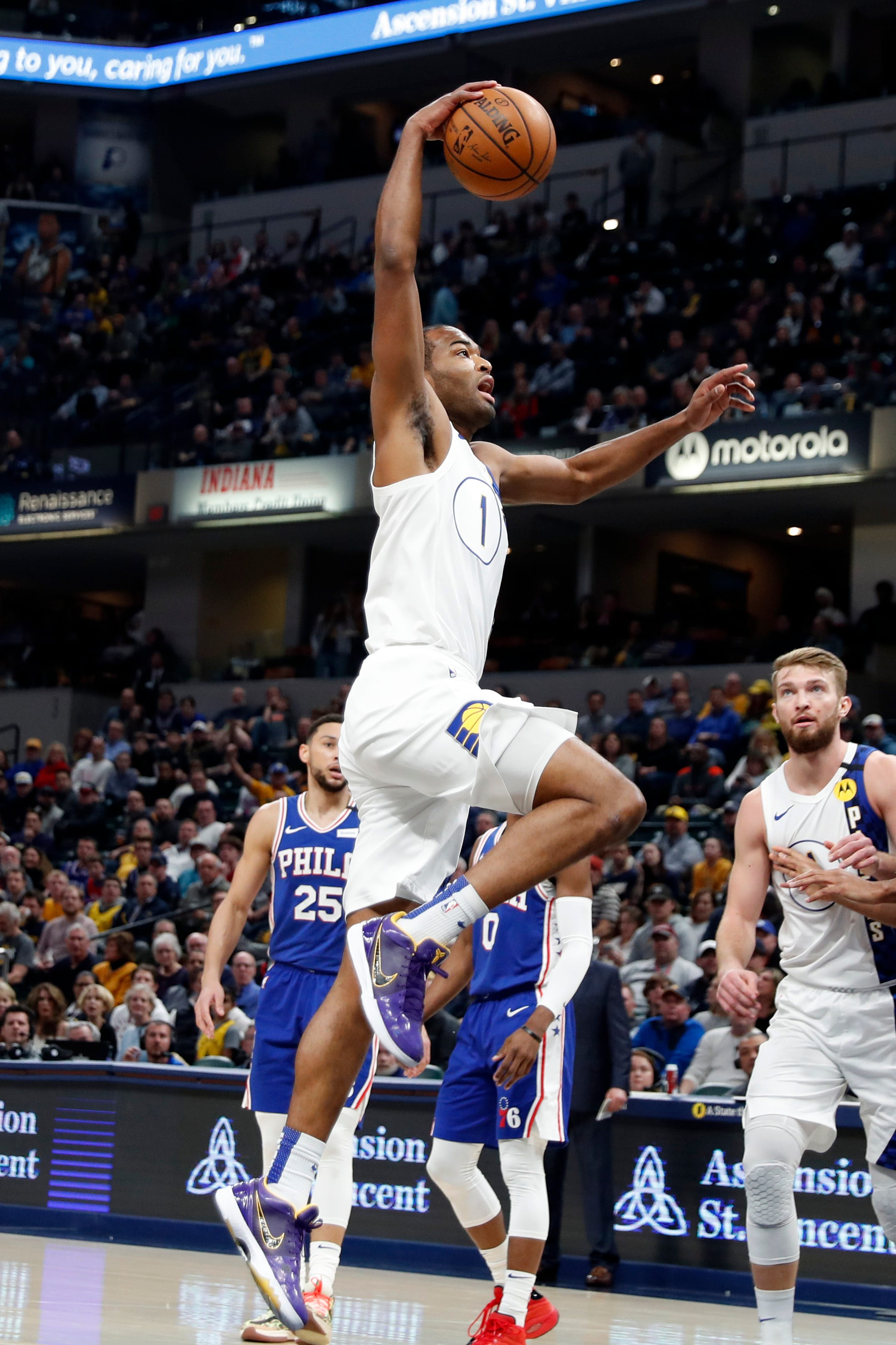 Jan 13, 2020; Indianapolis, Indiana, USA; Indiana Pacers forward T.J. Warren (1) dunks against the Philadelphia 76ers during the first quarter at Bankers Life Fieldhouse.