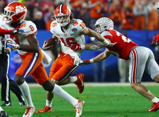 Clemson quarterback Trevor Lawrence runs with the ball against Ohio State during the 2019 Fiesta Bowl.