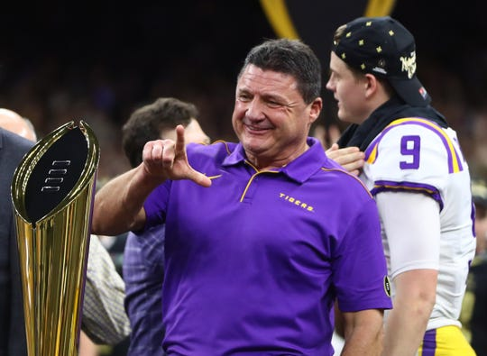 Ed Orgeron celebrates after LSU defeated Clemson.