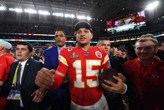 Kansas City Chiefs quarterback Patrick Mahomes celebrates after defeating the San Francisco 49ers in Super Bowl LIV. Mahomes passed for two touchdowns, ran for another and was named the game's MVP.