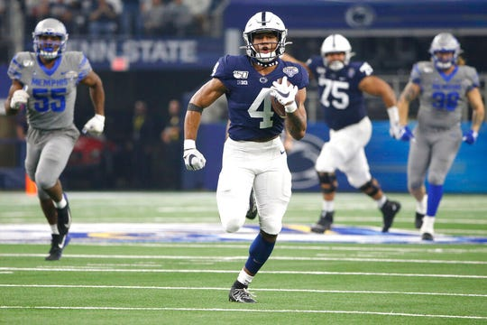Penn State running back Journey Brown carries the ball to the end zone for a touchdown against Memphis in the first half of the Cotton Bowl.