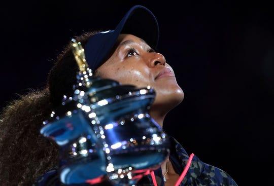 Naomi Osaka collects her second Australian Open trophy after beating American Jennifer Brady on Saturday.