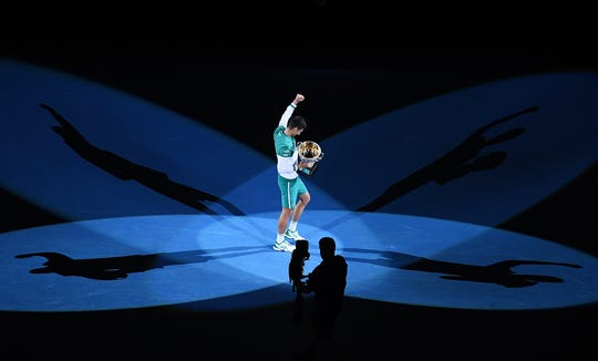 Novak Djokovic stands alone at the Australian Open after claiming his ninth men's singles championship at the Grand Slam event.